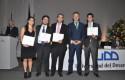 Rector y estudiantes premiados